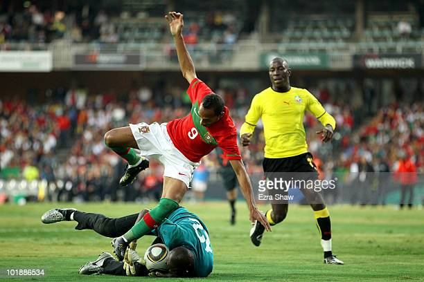 Liedson of Portugal topples over Joao Kapango of Mozambique during the international friendly match between Portugal and Mozambique at Wanderers...