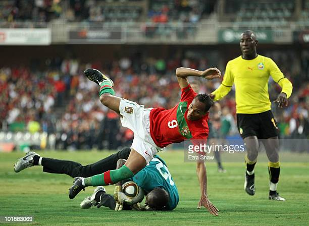 Liedson of Portugal topples over the goalie from Mozambique during their friendly match at Wanderers Stadium on June 8, 2010 in Johannesburg, South...