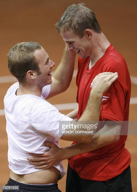 Belgian team Kristof Vliegen and Olivier Rochus celebrate as Vliegen won 6-4, 6-4, 6-4 the fifth game vs Australian Chris Guccione in the Davis Cup...