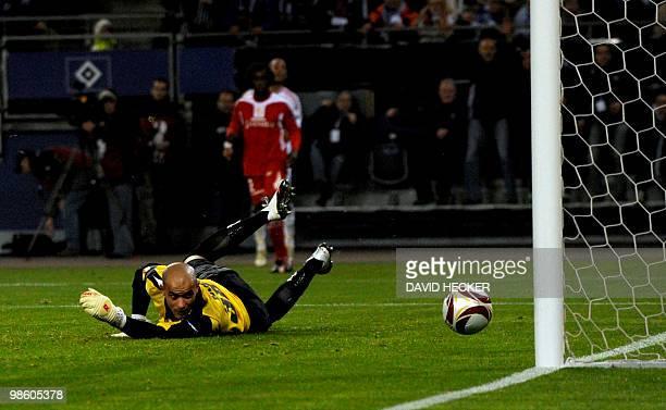 Liege's goalkeeper Sinan Bolat can't catch Hamburg's Dutch forward Ruud van Nistelrooy's ball during the UEFA Europa League 1st leg quarterfinal...