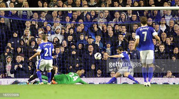 Lieghton Baines of Everton clears the ball off the line during The Barclays Premier League match between Everton and Newcastle United at Goodison...