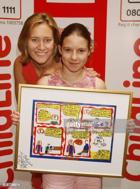 Lieha Parry from Scunthorpe Lincs with BBC TV news presenter Sophie Raworth and her award winning cartoon which she entered in the Childline Cartoon...