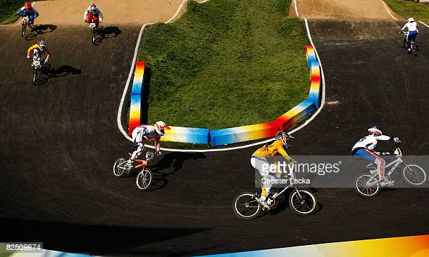 Lieke Klaus of the Netherlands, Nicole Callisto of Australia and Shanaze Reade of Great Britain compete in the Women's BMX semifinal run held at the...