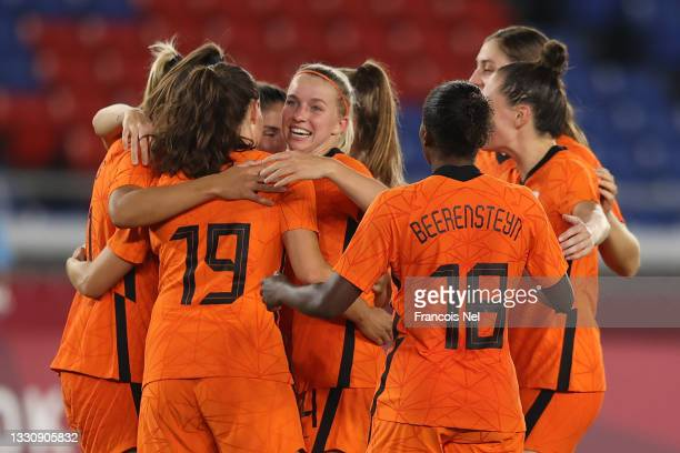 Lieke Martens of Team Netherlands celebrates with Jackie Groenen and teammates after scoring their side's fourth goal during the Women's Group F...