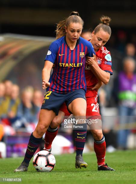 Lieke Martens of Barcelona is challenged by Gina Lewandowski of Bayern Munich during the UEFA Women's Champions League Semi Final second leg match...