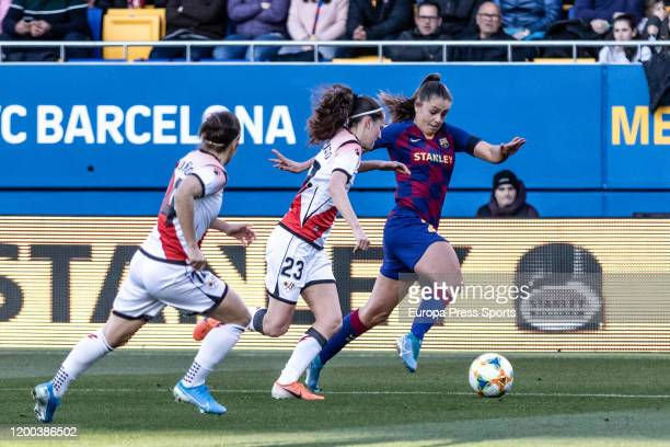 Lieke Martens of Fc Barcelona competes with Eva Alonso of Rayo Vallecano during the Spanish League Primera Iberdrola women football match played...
