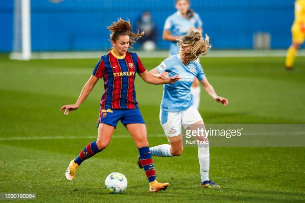 Lieke Martens of FC Barcelona defended by PSV player during the UEFA Champions League Women match between PSV v FC Barcelona at the Johan Cruyff...