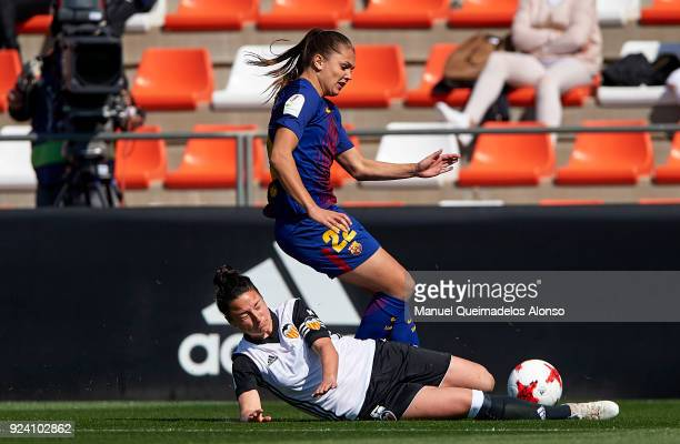 Lieke Martens of FC Barcelona is tackled by Ivana Andres of Valencia during the Liga Femenina match between Valencia CF Women and FC Barcelona Women...