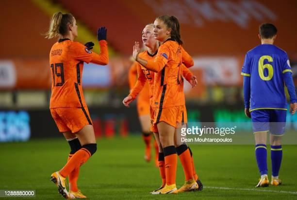 Lieke Martens of Netherlands celebrates with Inessa Kaagman and Jill Roord after scoring her sides third goal during the UEFA Women's EURO 2022...