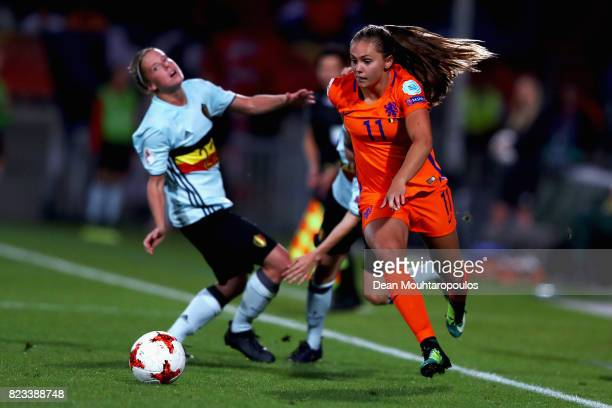 Lieke Martens of Netherlands gets past Laura Deloose of Belgium during the Group A match between Belgium and Netherlands during the UEFA Women's Euro...