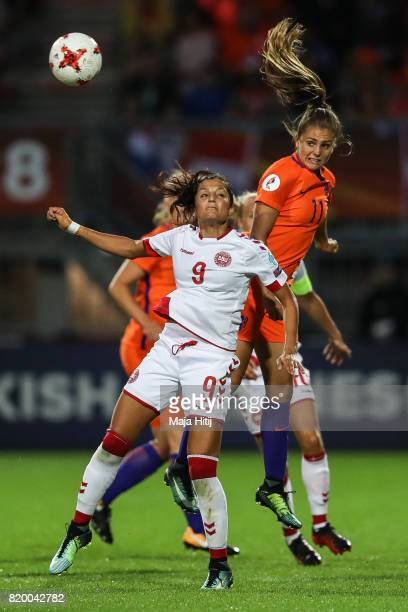 Lieke Martens of the Netherlands and Nadia Nadim of Denmark battle for the ball during the UEFA Women's Euro 2017 Group A match between Netherlands...