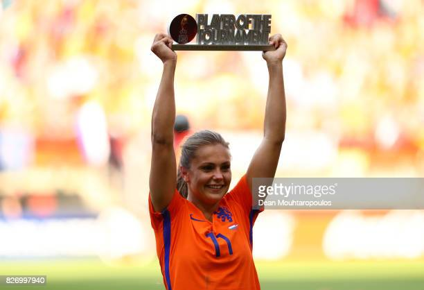 Lieke Martens of the Netherlands celebrates with her player of the tournament trophy following the Final of the UEFA Women's Euro 2017 between...