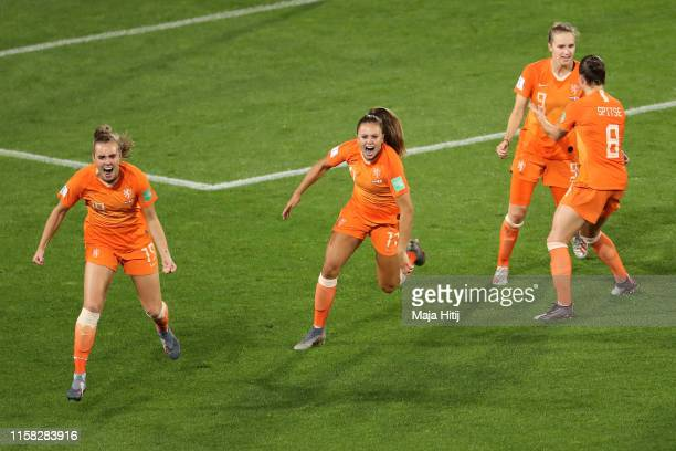Lieke Martens of the Netherlands celebrates with teammates after scoring her team's second goal during the 2019 FIFA Women's World Cup France Round...