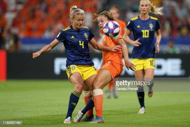 Lieke Martens of the Netherlands competes for the ball with Hanna Glas of Sweden during the 2019 FIFA Women's World Cup France Semi Final match...