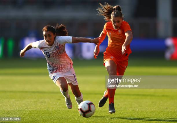 Lieke Martens of the Netherlands is challenged by Yessenia Huenteo of Chile during the International Friendly between Netherlands Women and Chile...