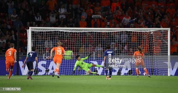 Lieke Martens of the Netherlands scores a penalty for her team's second goal during the 2019 FIFA Women's World Cup France Round Of 16 match between...