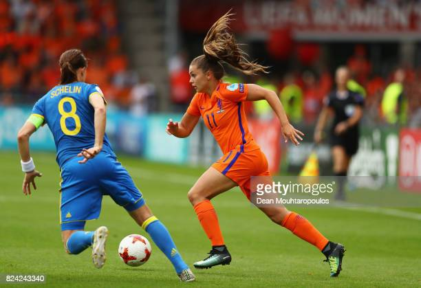 Lieke Martens of the Netherlands takes on Lotta Schelin of Sweden during the UEFA Women's Euro 2017 Quarter Final match between Netherlands and...