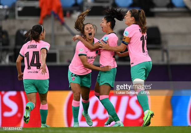 Lieke Martens, Vicky Losada and Alexia Putellas of FC Barcelona celebrate with team mates after their side's first goal, an own goal scored by...