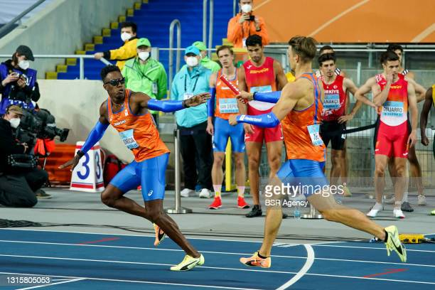 Liemarvin Bonevacia of The Netherlands and Jochem Dobber of The Netherlands make a change over in heat 2 of the Mens 4x400 metres relay during the...