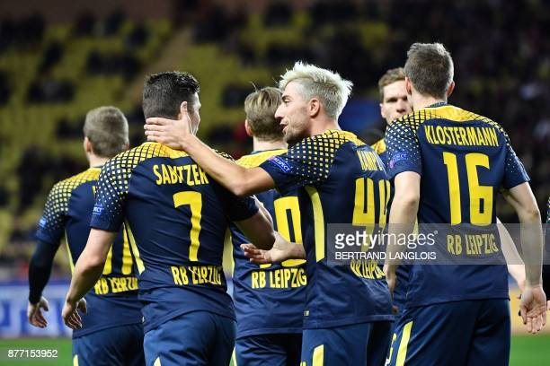 Liepzig's players celebrate after Monaco's Brazilian defender Jemerson scored a goal against his own team during the UEFA Champions League group G...