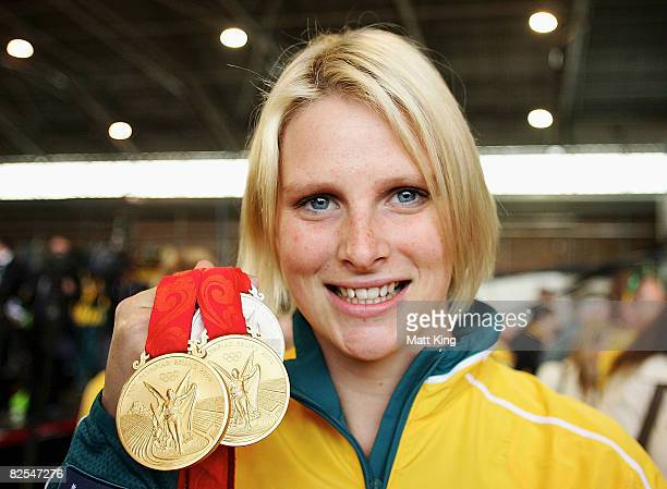 Liesel Jones displays her Olympic medals as the Australian Olympic team arrive home at Sydney Airport following the Beijing 2008 Olympics August 26,...
