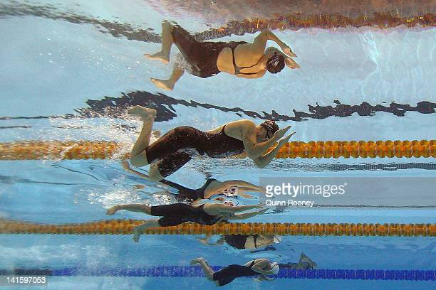 Liesel Jones, Karlene Pircher and Ashlea Gierke of Australia compete in the Semi Final of the Women's 200 Metre Breaststroke during day five of the...