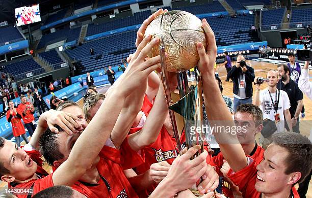 Lietuvos Rytas Vilnius players celebrate with the trophy during the Nike International Junior Tournament Final game between Lietuvos Rytas v...