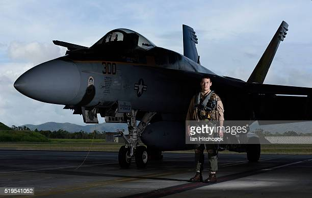 Lieutenant Christopher Pagenkopf a pilot in the United States Navy VFA115 squadron poses in front of a FA/18E Super Hornet in its hangar at the...