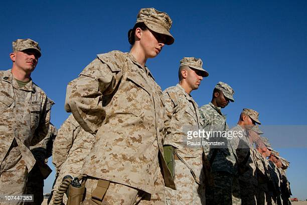 Lieutenant Colleen Farrell US Marine with the FET 1st Battalion 8th Marines Regimental Combat team II stands in formation during a ceremony for the...