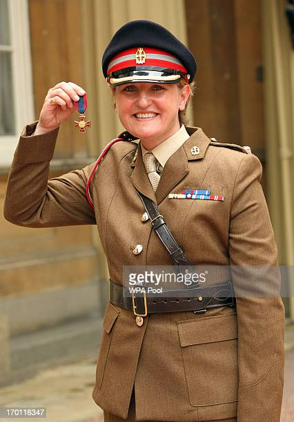 Lieutenant Colonel Andrea Lewis from Queen Alexandra's Royal Army Nursing Corps after receiving The Royal Red Cross medal from the Prince of Wales at...