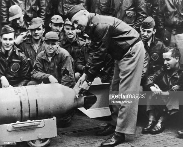 Lieutenant Colonel James Doolittle leans over a bomb on the deck of the USS Hornet just before the US began its bombing raid on Tokyo