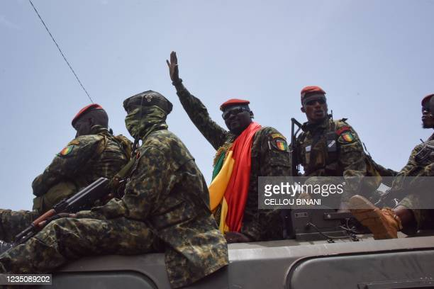 Lieutenant Colonel Mamady Doumbouya , head of the Armys special forces and coup leader, waves to the crowd as he arrives at the Palace of the People...