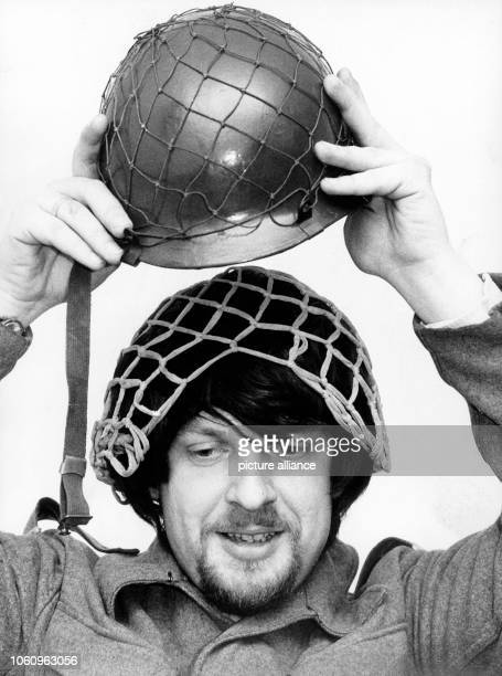 A lieutenant colonel tests with his wife's wig and hairnet how to place hair under a steel helmet Picture from February 1971 The hair decree by...