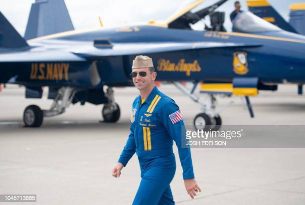 Lieutenant Commander Damon Kroes of the US Navy Blue Angels walks to his plane before a practice run for Fleet Week in Oakland California on October...