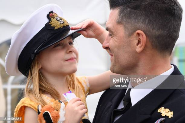 Lieutenant Commander Daniel Lee is greeted by his daughter Abigail after disembarking HMS Brocklesby on October 08, 2021 in Portsmouth, England. For...