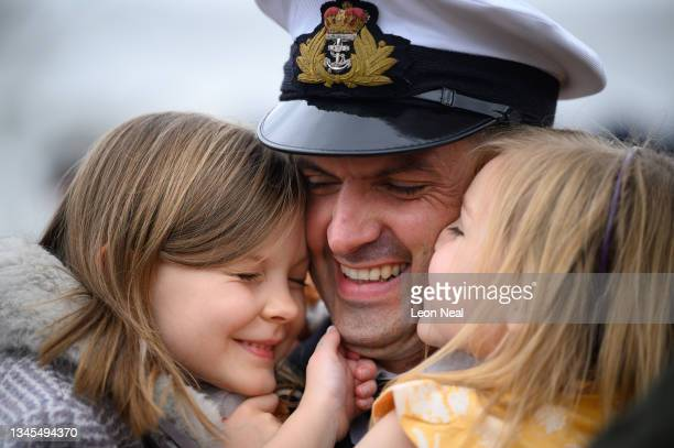 Lieutenant Commander Daniel Lee is greeted by his daughters Jemima and Abigail after disembarking HMS Brocklesby on October 08, 2021 in Portsmouth,...