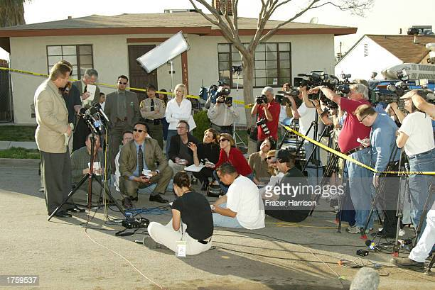 Lieutenant Daniel P Rosenberg from the homicide bureau speaks to the media outside of the entrance to 'Pyrenes Castle' record producer Phil Spector's...