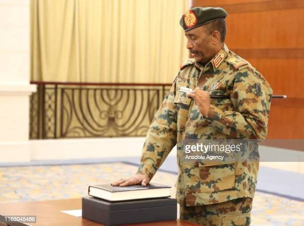 Lieutenant General Abdel Fattah alBurhan swear in as head of Sudan's sovereign council in the presence of Sudanese President of the Court of...