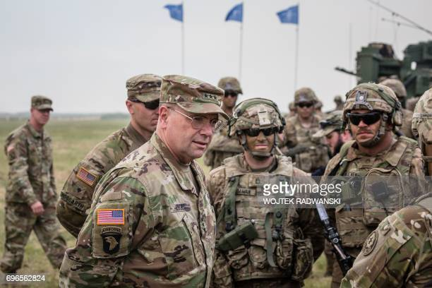 Lieutenant General Ben Hodges commanding general of the US Army in Europe chats with American Soldiers after NATO Saber Strike military exercises on...
