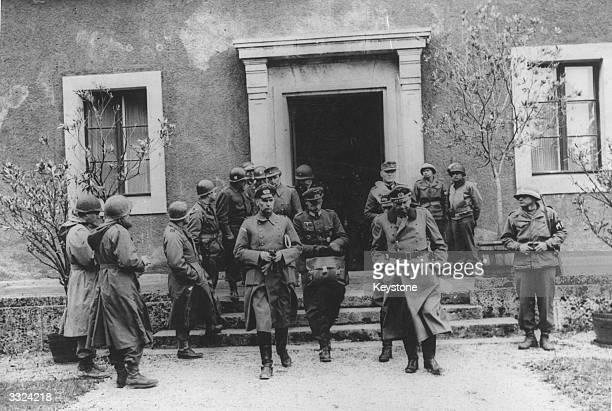Lieutenant General Foertch of the 1st German Army leaves the Thorak Estate near Haar with the delegation who formally surrendered Germany Army Group...