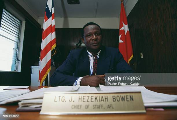 Lieutenant General J Hezekiah Bowen Chief of Staff of the Armed Forces of Liberia and Minister of Defense during the Liberian Civil War sits behind...
