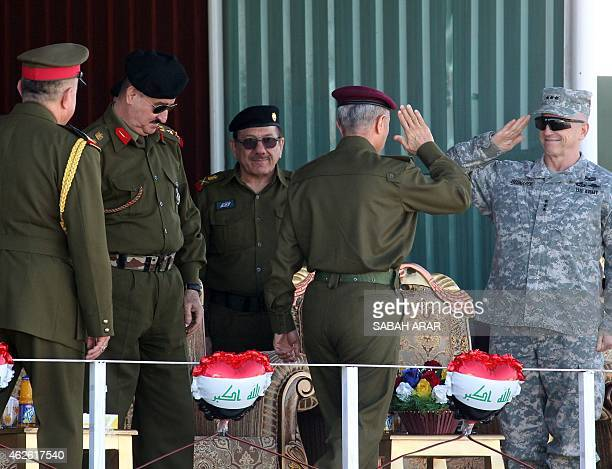 US Lieutenant General John M Bednarek chief of the Office of Security CooperationIraq greets Iraqi army officials as he arrives to attend a military...