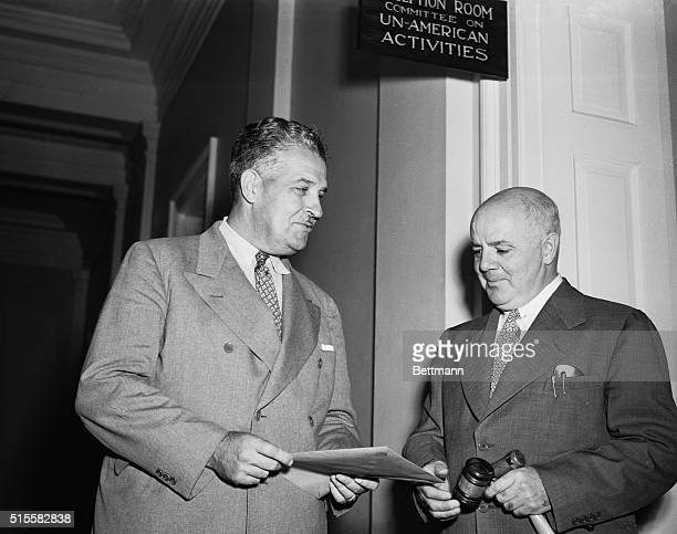 Lieutenant General Leslie R Groves wartime Army Chief of the Atomic Bomb Project confers with Representative J Parnell Thomas Chairman of the House...