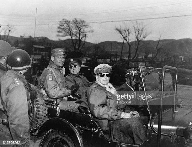 Lieutenant General Matthew Ridgway Major General Doyle Hickey and General Douglas MacArthur Commander in Chief of UN Forces sit in a jeep at a...