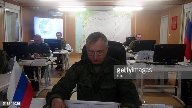 Lieutenant General Sergey Kirilenko works behind his desk on March 17 2016 in Russia's reconciliation center as the team monitors the truce in Syria...