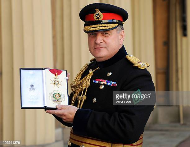 Lieutenant General Sir Barnabas WhiteSpunner poses after he is made a Knight Commander of the Order of the Bath at an Investiture ceremony at...