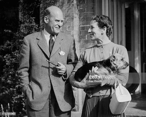 Lieutenant General Sir Douglas Packard and Lady Packard, posing together outside Cloona House, the official residence of the GOC's in Northern...