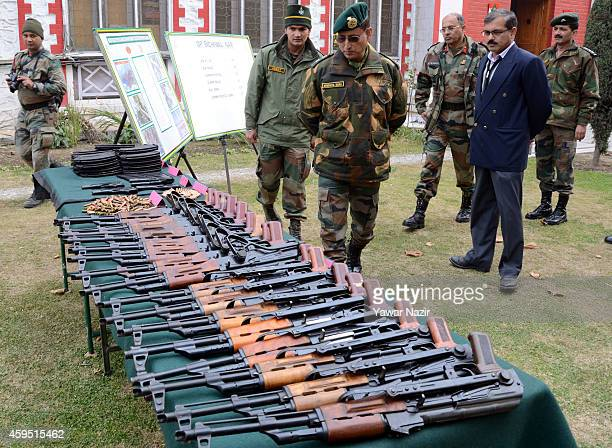 Lieutenant General Subrata Saha of Indian Army inspects seized arms and ammunitions recovered by them in Kupwara near the ceasefire line or Line of...
