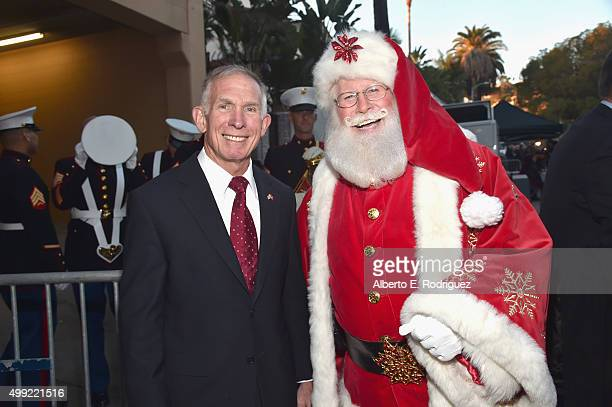 Lieutenant General USMC and President CEO of the Marine Toys for Tots Foundation Pete Osman and Santa attend 2015 Hollywood Christmas Parade on...