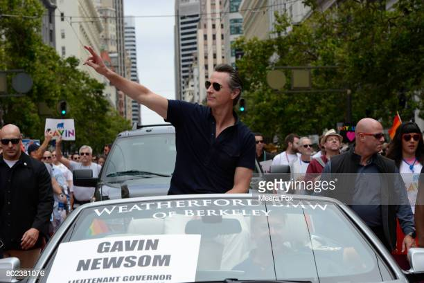 Lieutenant Governor Gavin Newsom rides in the San Francisco Gay Pride parade on June 25 2017 in San Francisco California